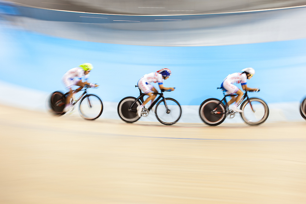 The Costa Rican team competes in the women's team pursuit qualification on the fist day of track cycling at the 2015 Pan American Games in Toronto, Canada, July 16,  2015.  AFP PHOTO/GEOFF ROBINS