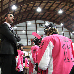Mississauga, ON  - Feb 15 : Ontario Junior Hockey League game action between the Mississauga Chargers vs Cobourg Cougars, coach Joe Washkurak keeps a watchful eye on the action. <br /> (Photo by Kevin Sousa / OJHL Images)