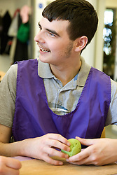 Day Service users with learning disabilities in an arts and craft session,
