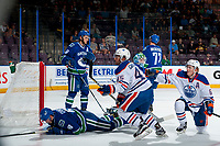 PENTICTON, CANADA - SEPTEMBER 11: Joseph Gambardella #45 of Edmonton Oilers puts the puck past Thatcher Demko #35 of Vancouver Canucks during second period on September 11, 2017 at the South Okanagan Event Centre in Penticton, British Columbia, Canada.  (Photo by Marissa Baecker/Shoot the Breeze)  *** Local Caption ***