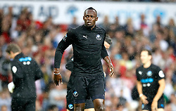 World XI's Usain Bolt warms up prior to the UNICEF Soccer Aid match at Old Trafford, Manchester.