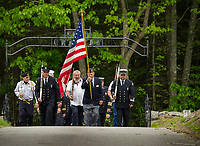 The Color Guard marching into Oakland Cemetery Monday morning during Meredith Center's Memorial Day service.  (Karen Bobotas/for the Laconia Daily Sun)