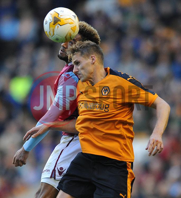 Jordan Amavi of Aston Villa challenges for the header with James Henry of Wolves - Mandatory by-line: Dougie Allward/JMP - 07966386802 - 28/07/2015 - SPORT - FOOTBALL - Wolverhampton,England - Molineux Stadium - Wolves v Aston Villa - Pre-Season Friendly