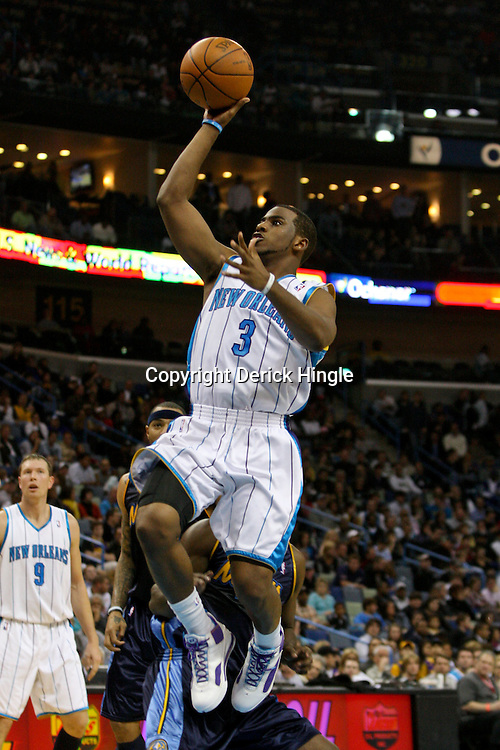 Dec 18, 2009; New Orleans, LA, USA; New Orleans Hornets guard Chris Paul (3) shoots against the Denver Nuggets during the first half at the New Orleans Arena. Mandatory Credit: Derick E. Hingle-US PRESSWIRE