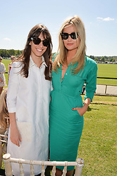 Left to right, LAURA JACKSON and LAURA WHITMORE at the St.Regis International Polo Cup at Cowdray Park, Midhurst, West Sussex on 16th May 2015.