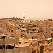 Town of Palmyra (or Tadmur), Syria, just as a dust-storm approaches