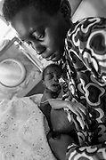 Bea Ahbeck/Fremont Argus<br /> <br /> Gladys Nalwadda, 18, sits with her prematurley born son in the preemie ward at Mulago Hospital in Kampala, Uganda, Nov. 7, 2005.