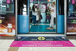 Female passengers in women only carriage on metro train in Dubai United Arab Emirates