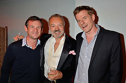 Left to right, DOMINIC TREDWELL-COLLINS, GRAHAM NORTON and GRAHAM BROADBENT at a party to celebrate the publication of Holding by Graham Norton held at Liberty, Regent Street, London on 12th October 2016.