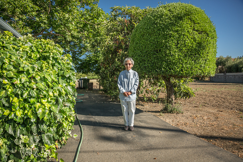 """I graduated from Saint Helena High School in 1943, went to work at the Mare Island Shipyard in Vallejo and continued to work there for 37 years.  I worked with some of the early computers...IBM, Honeywell, and Univac.  I bought this house in 1952 and I've been here ever since.""  - Ninety three year old Mary Edano stands near her home in Saint Helena, California."