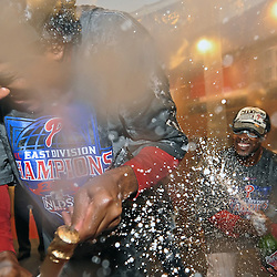 PHILADELPHIA - SEPTEMBER 30: Jimmy Rollins #11 of the Philadelphia Phillies squirts champagne on teammate Pedro Martinez #45 after beating the Houston Astros 10-3 and winning the National League East on September 30, 2009 at Citizens Bank Park in Philadelphia, Pennsylvania. (Photo by Drew Hallowell/Getty Images)