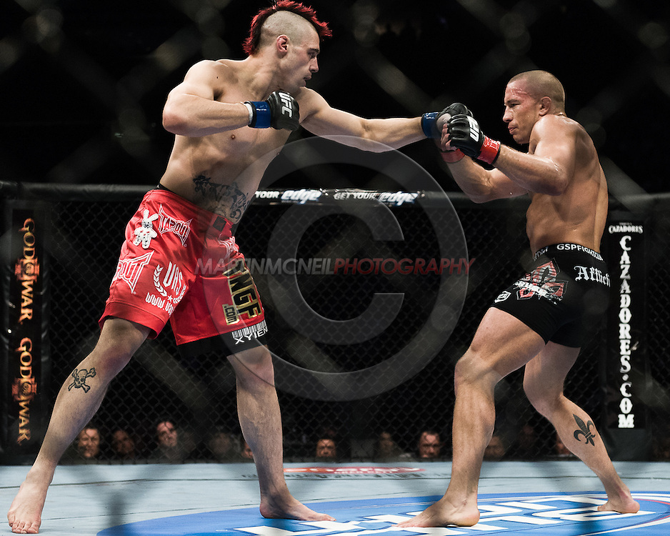 "NEWARK, NEW JERSEY, MARCH 27, 2010: Georges St. Pierre and Dan Hardy are pictured during their bout at ""UFC 111: St. Pierre vs. Hardy"" in the Prudential Center, New Jersey on March 27, 2010"