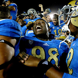 UCLA 's Takkarist McKinley (98) celebrates with teammates after defeating Southern California 38-20 during a NCAA college football