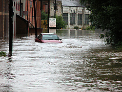 Car partially submerged on Butterthwait Lane Ecclesfield..15th June 2007.Image COPYRIGHT Paul David Drabble.