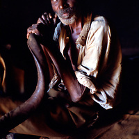 Official horn blower to summon people to Modjadji's ceremonies. Greg Marinovich 1988.