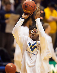 Jan 20, 2016; Morgantown, WV, USA; West Virginia Mountaineers forward Devin Williams (41) warms up before their game against the Texas Longhorns at the WVU Coliseum. Mandatory Credit: Ben Queen-USA TODAY Sports