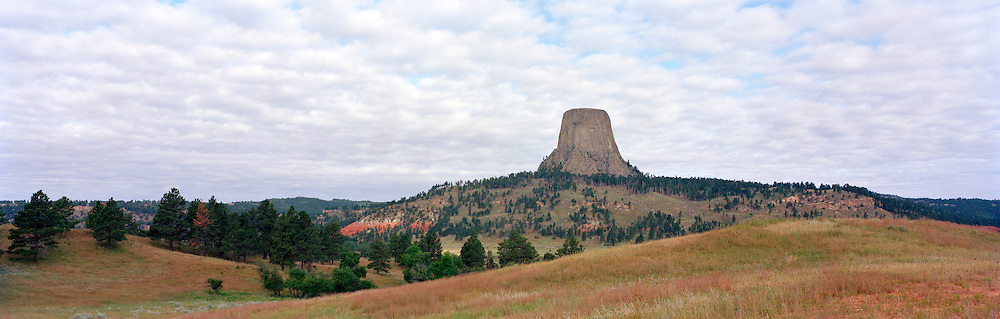 Panoramic view of Devil's Tower National Monument at sunrise.