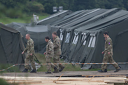 © licensed to London News Pictures. London, UK 18/07/2012. Soldiers walking at their military base in Hainault Country Park in Redbridge, east London. The base will accommodate 3,000 soldiers during the Olympics. Photo credit: Tolga Akmen/LNP