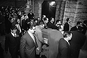 The coffin bearing the remains of Brendan Behan is carried into the Church of the Sacred Heart, Donnybrook, flanked by a guard of honour.  Mrs. Beatrice Behan, the playrights wife, is immediatley behind the coffin..21.03.1964