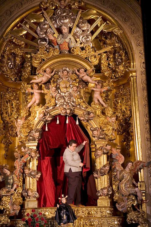 Preparing a chapel in the Cathedral for Holy Week. Salamanca, Spain during Semana Santa (Holy Week).