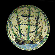 Dish painted with a pagoda-like structure and a Greek inscription round the rim.  'Lord turn not thy face against us' and a date 23/5/1666.  Lznik or the Ottoman provinces.