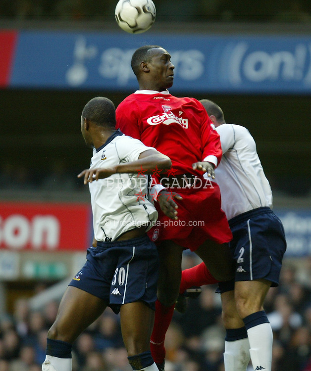 LONDON, ENGLAND - Saturday, January 17, 2004: Liverpool's Emile Heskey wins a header against two  Tottenham players during the Premiership match at White Hart Lane. (Pic by David Rawcliffe/Propaganda)