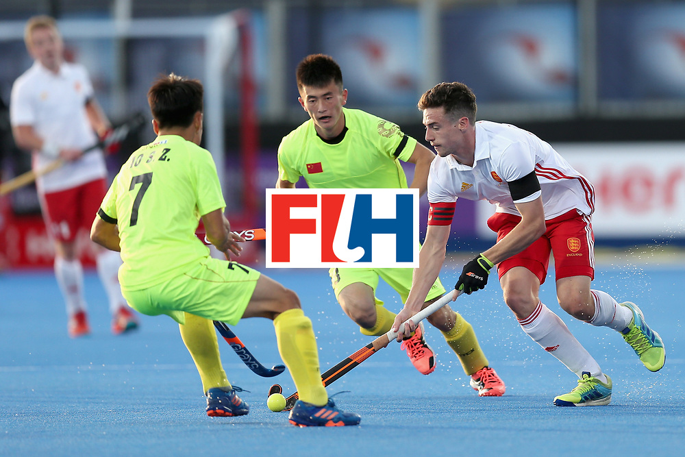 LONDON, ENGLAND - JUNE 15:  Phil Roper of England attempts to take the ball past Suozhu Ao of China during the Hero Hockey World League Semi Final match between England and China at Lee Valley Hockey and Tennis Centre on June 15, 2017 in London, England.  (Photo by Alex Morton/Getty Images)