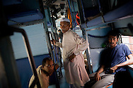 A passenger from Gujarat walks up and down the coach, stretching his legs...Train passengers on the Himsagar Express 6318 going from Jammu Tawi station to Kanyakumari on 8th July 2009.. .6318 / Himsagar Express, India's longest single train journey, spanning 3720 kms, going from the mountains (Hima) to the seas (Sagar), from Jammu and Kashmir state of the Indian Himalayas to Kanyakumari, which is the southern most tip of India...Photo by Suzanne Lee / for The National