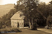 Weathered barn in monotone.