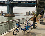 Citibike ride along the East River, Lower Manhattan, New York City, Model Released