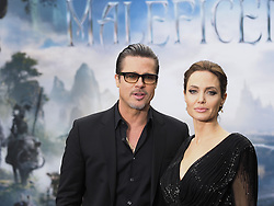 Angelina Jolie arrives with Brad Pitt at the Premiere of her latest film Maleficent in  Kensington Palace, London, United Kingdom. Thursday, 8th May 2014. Picture by Max Nash / i-Images