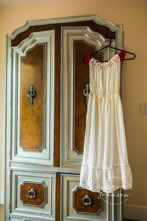 Dress hanging off wardrobe, Astoria, Oregon, USA