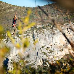 Swiss highliner Simon Egger sending a very long, 40m highline, 200m high, rigged in the Sordidon sector of Verdon Gorges, France...2012 © Pedro Pimentel