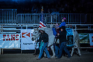 A young girl with TR4 Heart & Soul presents the American flag for the anthem during the Bismarck Rodeo on Saturday, Feb. 3, 2018. More photos of each run are available at Bobwire-S.com.
