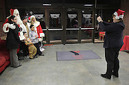 Middletown, New York - A family gets their picture taken with Santa and his helpers at the Middletown YMCA on Dec. 4, 2010.