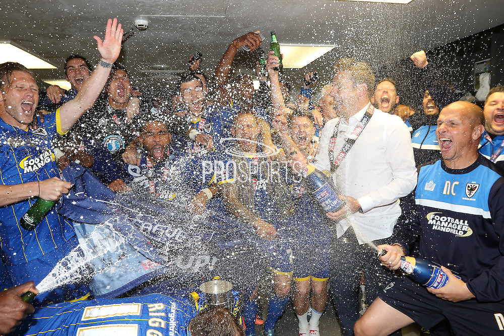 Changing room celebrations after  AFC Wimbledon seal promotion to League One, after beating Plymouth Argyle Football Club 2-0 during the Sky Bet League 2 play off final match between AFC Wimbledon and Plymouth Argyle at Wembley Stadium, London, England on 30 May 2016. Photo by Stuart Butcher.