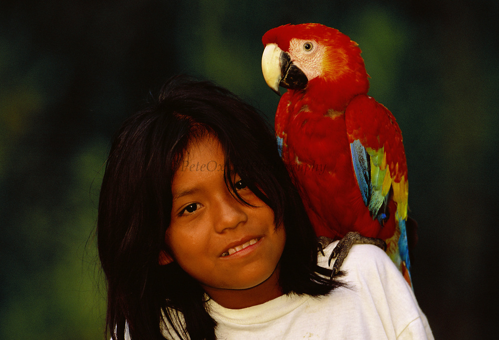Machiguenga Indian with Scarlet Macaw<br />