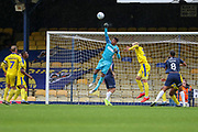 AFC Wimbledon goalkeeper Nathan Trott (1) about to punch the ball during the EFL Sky Bet League 1 match between Southend United and AFC Wimbledon at Roots Hall, Southend, England on 12 October 2019.