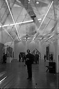 1/11/1967<br /> 11/11/1967<br /> 11 November 1967<br /> ROSC Art Exhibition 1967.<br /> John Latham standing under his exhibit Soft Skoob 1966 hung at the ROSC exhibition at the Royal Dublin Society, Dublin.