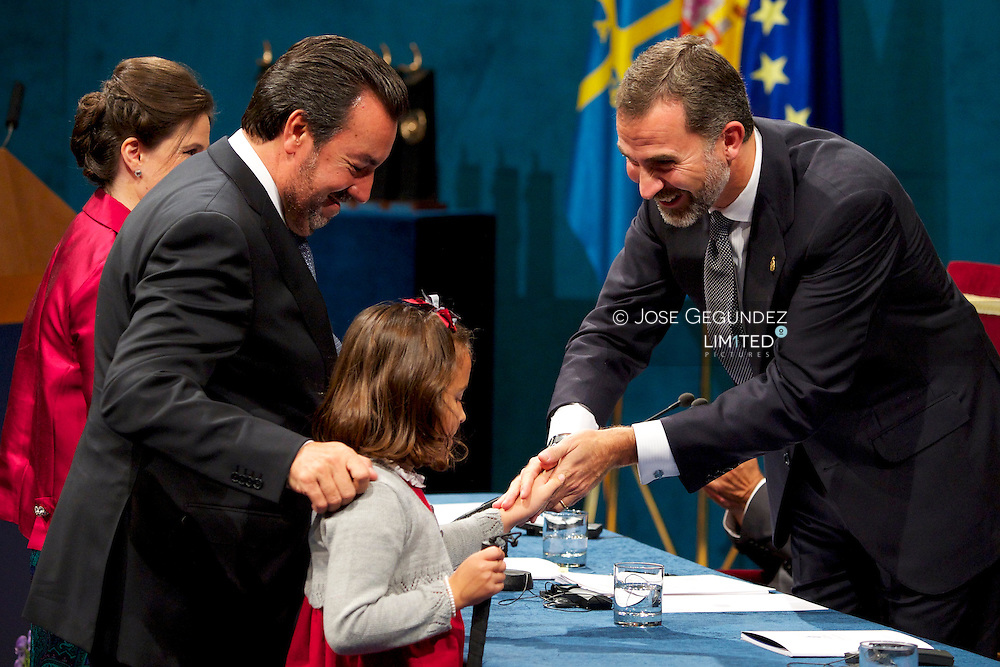 Prince Felipe of Spain delivery 'Prince of Asturias Awards 2013' to Miguel Carballeda, ONCE's President, during ceremony Gala at the Campoamor Theater on October 25, 2013 in Oviedo, Spain.