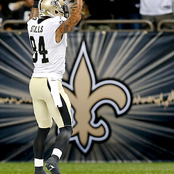 Aug 16, 2013; New Orleans, LA, USA; New Orleans Saints wide receiver Kenny Stills (84) celebrates after a touchdown catch against the Oakland Raiders during the first quarter of a preseason game at the Mercedes-Benz Superdome. Mandatory Credit: Derick E. Hingle-USA TODAY Sports