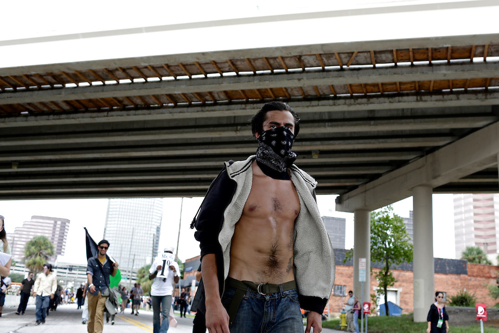 Protestor William Estrella marches toward the 2012 Republican National Convention in Tampa, Fla. on Aug. 27, 2012.