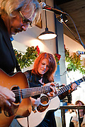John Leventhal performing with Rosanne Cash at Waterloo Records, Austin Texas, December 5, 2009. Rosanne Cash (born May 24, 1955) is an American singer-songwriter and author. She is the eldest daughter of the late country music singer Johnny Cash and his first wife, Vivian Liberto Cash Distin. Waterloo Records is an independent record store in Austin Texas.
