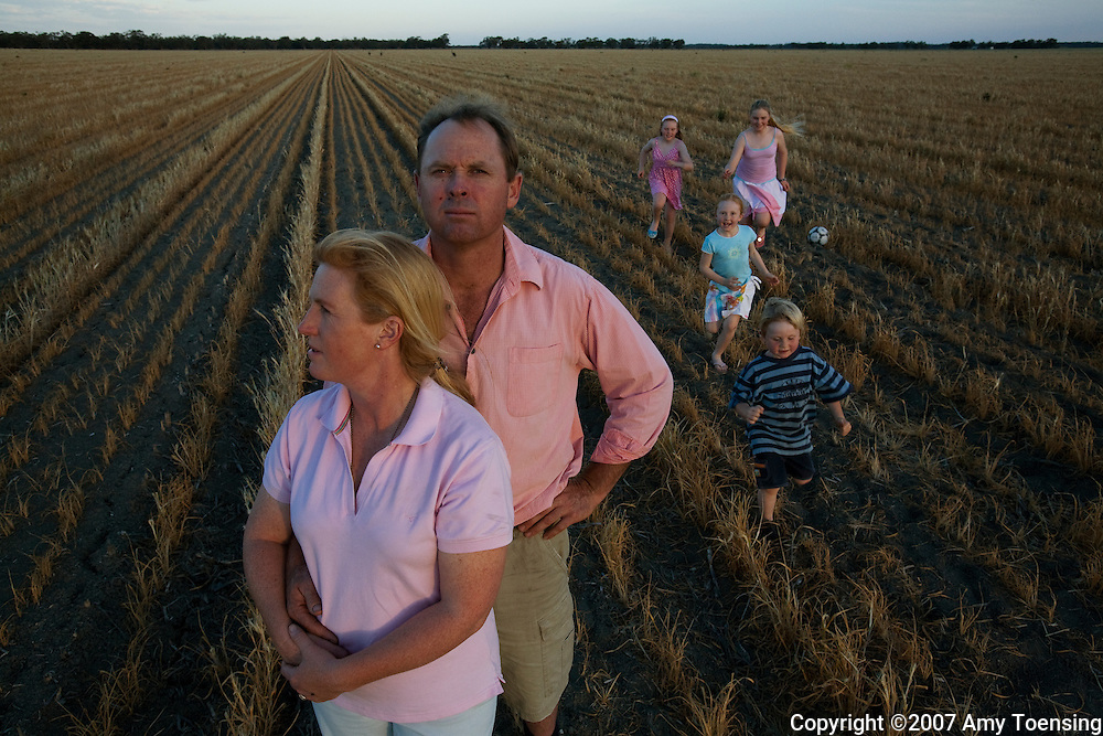 HAY, NSW, AUSTRALIA - OCTOBER 21: Irrigation farmers Nick and Felicity Maynard with their four children in the middle of one of their failed wheat crops October 21, 2007 in Hay, New South Wales, Australia. The Maynard's, like many farmers in the Murray-Darling basin, planted wheat last May when it rained for just a few weeks, but then stopped. Now the family is faced with zero water allocations and will not plant anything unless water allocations return. The Murray-Darling Basin of Australia has been plagued with severe drought since the late 1990's and many growers and policy makers are being forced to work on implementing more efficient irrigation systems. (Photo by Amy Toensing / Reportage by Getty Images).. _________________________________<br />