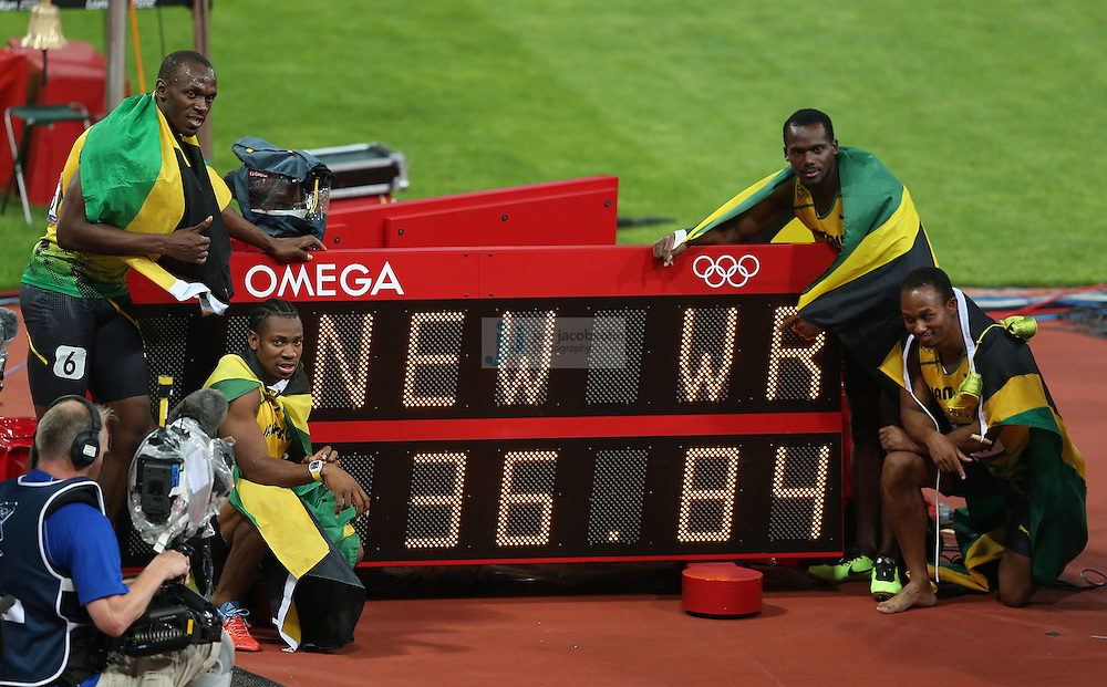 Members of the Jamaican relay team pose for pictures after breaking the world record after the men's 4x100 relay race at the Olympic stadium during day 15 of the London Olympic Games in London, England, United Kingdom on August 11, 2012..(Jed Jacobsohn/for The New York Times)..