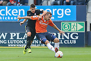 York City midfielder Michael Coulson tries to get past Luton Town defender Luke Wilkinson  during the Sky Bet League 2 match between Luton Town and York City at Kenilworth Road, Luton, England on 10 October 2015. Photo by Simon Davies.
