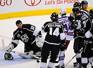 Kings' goaltender Jonathan Quick sneers at the Rangers' after being knocked over by Benoit Pouliot during the first period of Game 5 of the 2014 NHL Stanley Cup Final at Staples Center Friday.