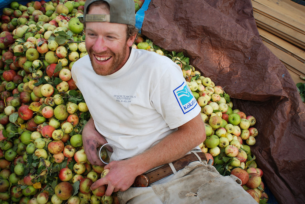 Buck Farley (center) enjoys the autumn tradion of apple cidar pressing, Durango, CO.