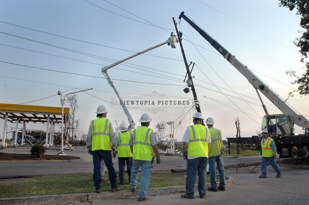 Work crews repair electrical lines in Tuscaloosa, Alabama, Saturday, April 30, 2011 following the April 27, 2011 tornado outbreak, which is considered to be the second deadliest in US history.Tuscaloosa, Alabama, Saturday, April 30, 2011. Tornado Damage in Alabama 2011