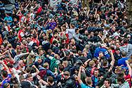 ROTTERDAM - Feyenoord-fans vieren na het laatste fluitsignaal feest op het Stadhuisplein waar ze op grote schermen de wedstrijd tegen Heracles hebben kunnen volgen. De voetbalclub uit Rotterdam is kampioen van de eredivisie geworden.ROBIN UTRECHT